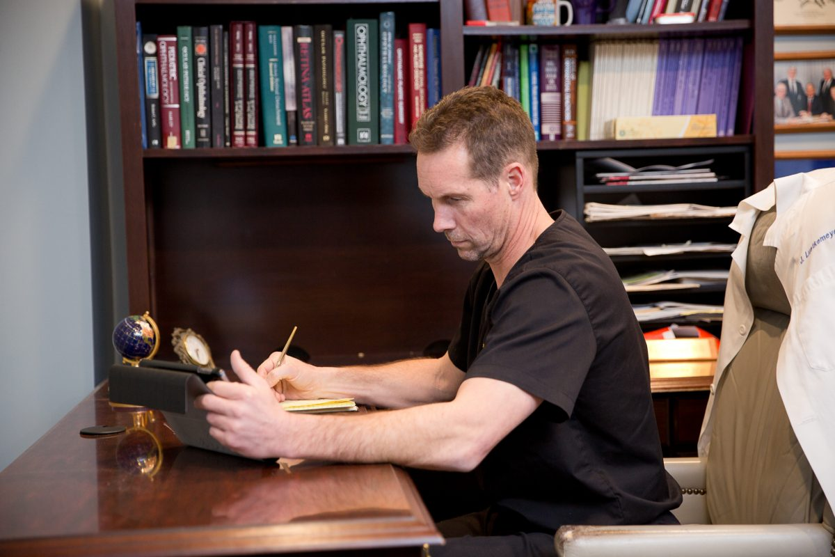 Dr. Leutkemeyer at his desk